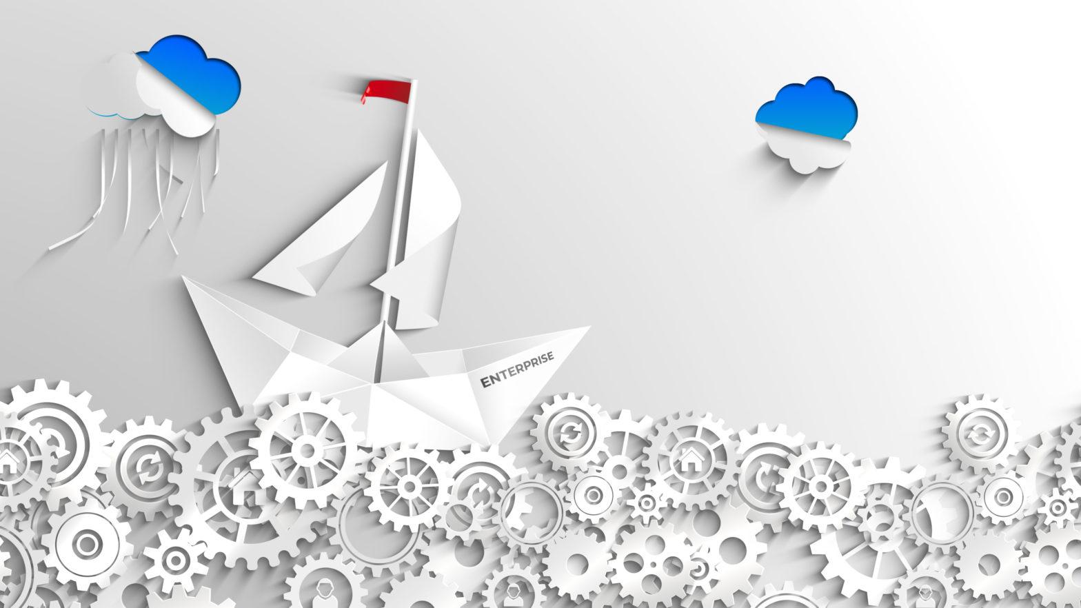 Papierschiff auf einem Meer von Papierzahnraedern